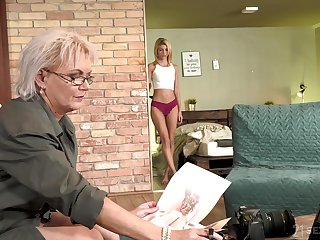 Sexy GILF photographer having making love beside a pretty young woman