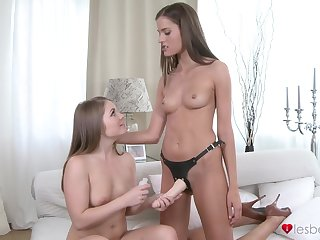 Energized lesbians are on the qui vive to use this strap-on for their tiny pussies